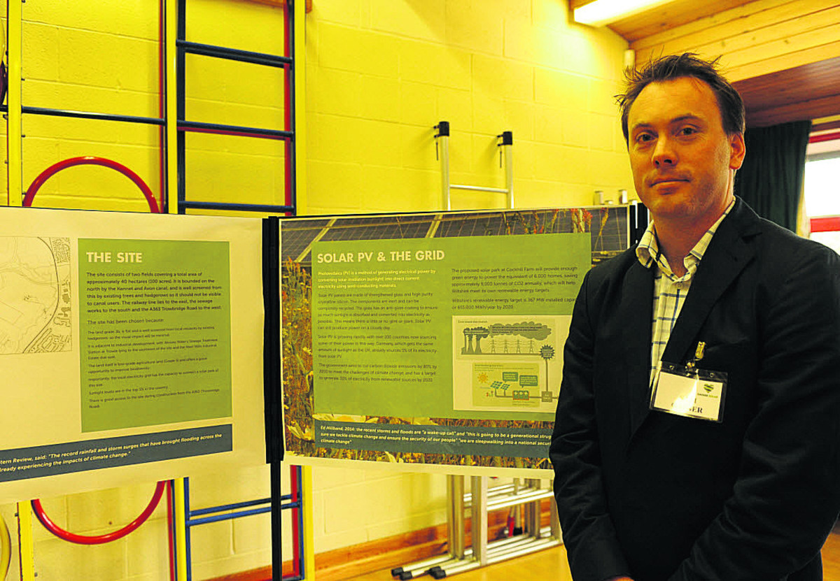 Sam Gaiger with the plans for the renewable energy project at Cockhill Farm