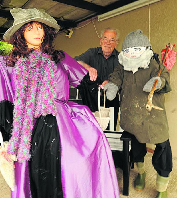 Wiltshire Times: Brian Park and some of the scarecrows he has made for the event at Grove School