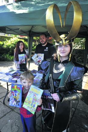 Elsa Oakley, dressed as Loki, and Maxwell Walters, as Spiderman, at the free comic book day