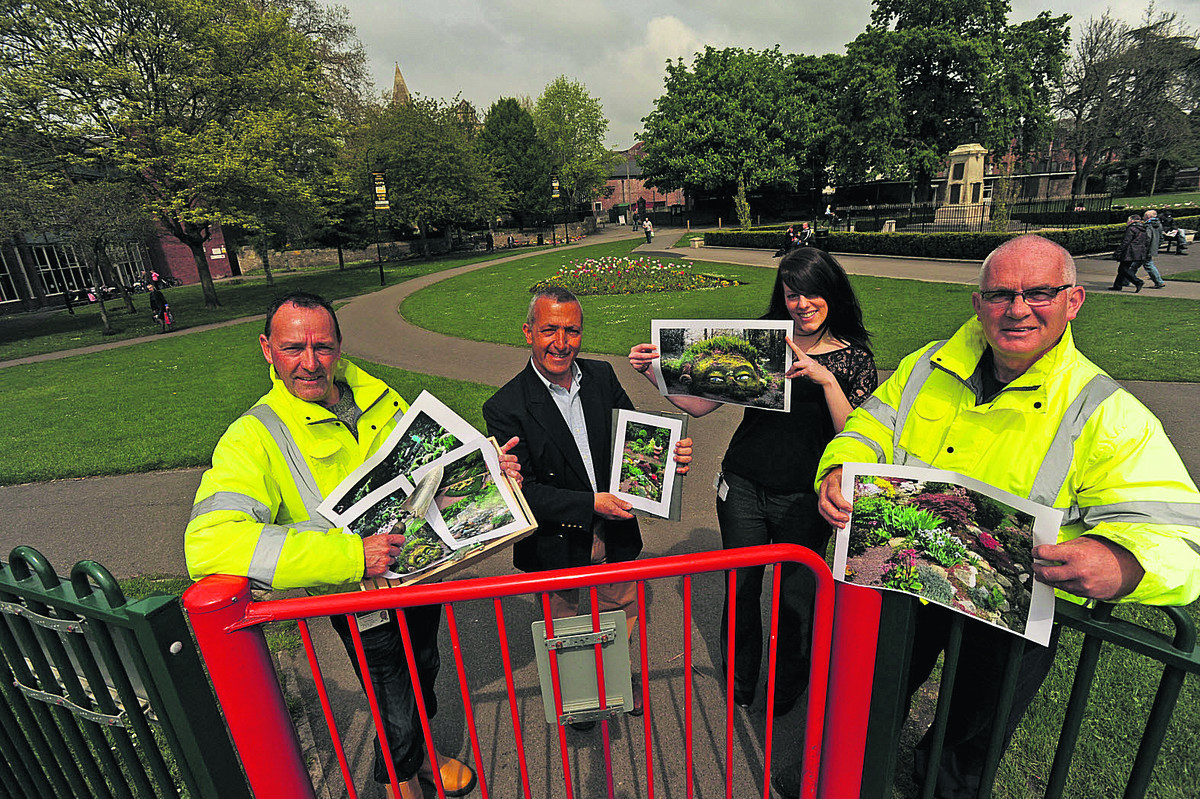 Staff member Nick Allford ,Sharl Adabashi with Town Council staff – Becci Mees and Bill Austin – with the plans for rock and herb gardens in Trowbridge Park.                 Photo: Trevor Austin (48723)