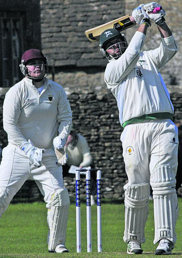 Wiltshire Times: Wiltshire skipper Mike Coles hits a six on his way to a half-century against Cornwall on Sunday (Picture by Trevor Porter)