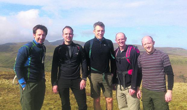 Dan Jones, James Vaughton, John Fuggle, Dave Joyce and Tom Vaughton train on the Brecon Beacons ahead of their challenge next month