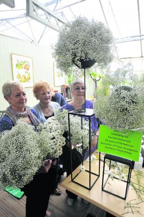 Nancy Newman, Rosalyn Clarke and Christine Oughton of the Melksham & District Flower Arrangement Society with their Emerald anniversary display  (49369-1)