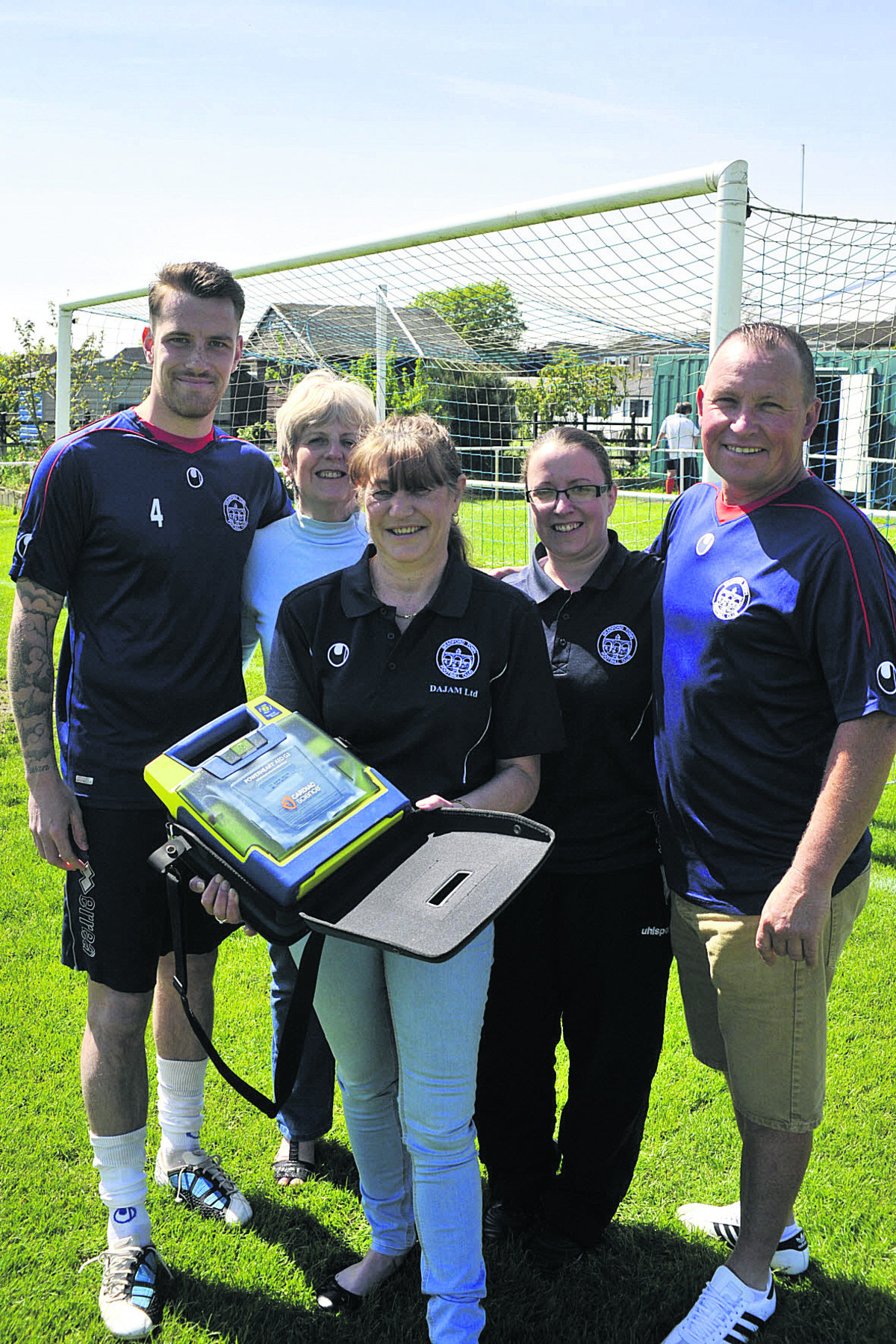 Bradford Town FC captain Tom Evans, treasurer Pat Stevens, secretary Nikki Akers and committee members Vikki Cumming and Adie Hiscocks with the club's first defib