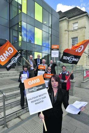 GMB union regional organiser Carole Vallelly, front, and supporters stage their protest outside County Hall today