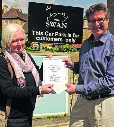 Terry McClure, of Wiltshire Wildlife Hospital, receives a cheque from James Sullivan-Tailyour for money raise from Bradford on Avon's swan sweepstake. (48780) Picture by Trevor Porter
