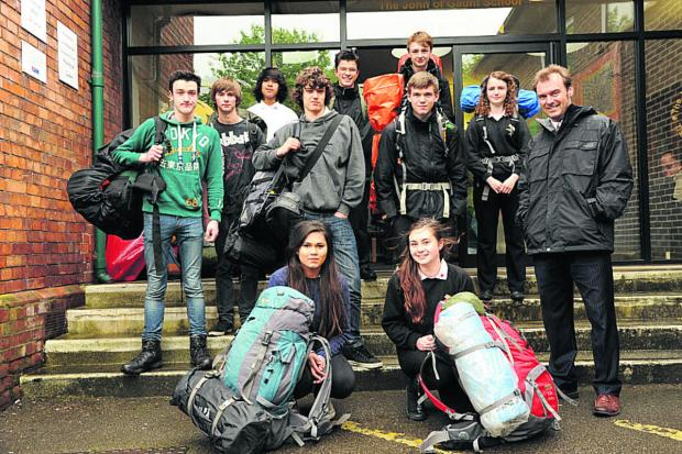 Team leaders Leisha Mortimer and Annie Littlejohns with the John of Gaunt School teams before they set off for the Ten Tors challenge with tutor Stuart Gray. (48758) Picture by Trevor Porter