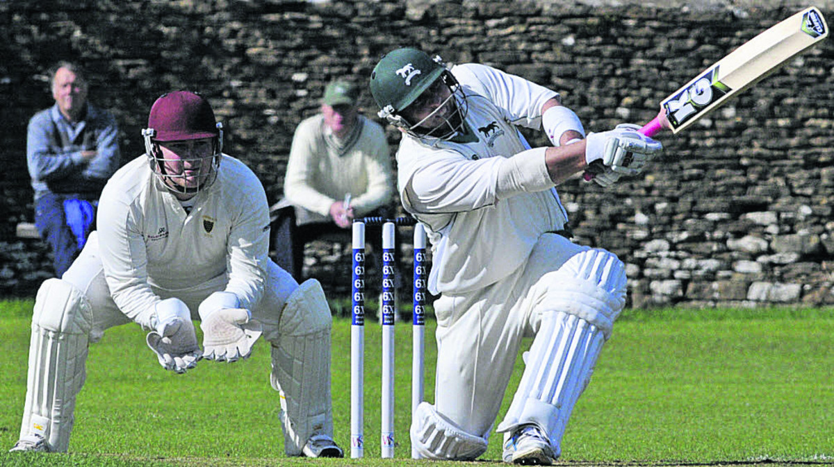 Wiltshire's Joe Breet hits another boundary during Sunday's win over Cornwall, watched by wicketkeeper Paul Smith