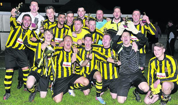 Wiltshire Times: Trowbridge Town Reserves celebrate after clinching the Spring Cup last Friday night