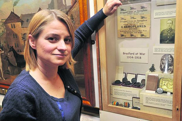 Bradford on Avon Museum trustee Kate Turnbull with their current, rather sparse, selection of First World War exhibits