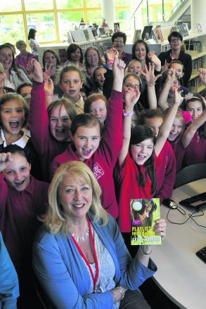 Cathy Hopkins with a delighted group of pupils who were thrilled to meet one of their favourite authors