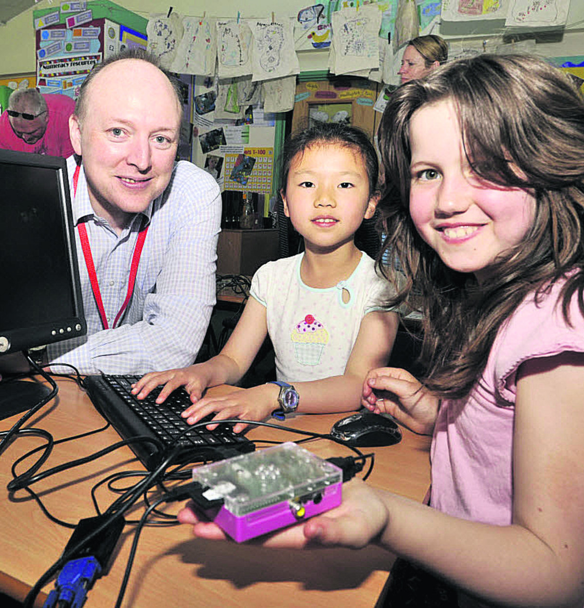 Emily Jacob and Liana Tiany enjoy the Raspberry Pi  jam session run by Alan O' Donohoe Hundreds of families enjoyed fascinating activities at The Mead CP School's community science and technology day