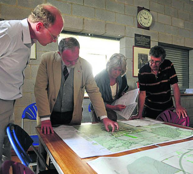 Edward Barham, second from left, talks about Robert Hitchins' plans at Kington Langley Village Hall