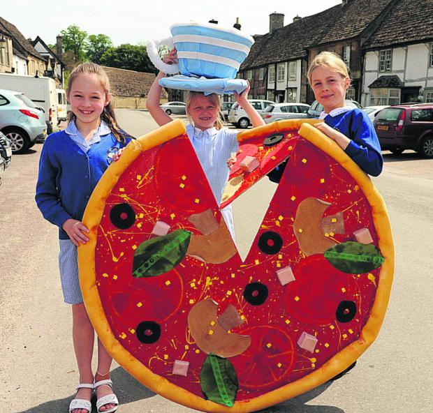 Wiltshire Times: Lacock School pupils Charlotte, Erin and Olivia with some of the creations for the bank holiday scarecrow trail