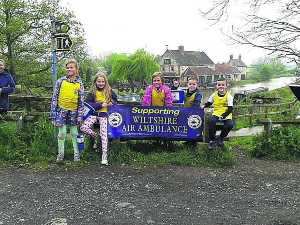 From left, Bowerhill School sponsored walkers Niamh Sayer, Abbie Craig, Phoebe Sayer, Ben Phillips, all nine, and seven-year-old Jamie Phillips pictured at the end of their walk along the Kennet and Avon canal.