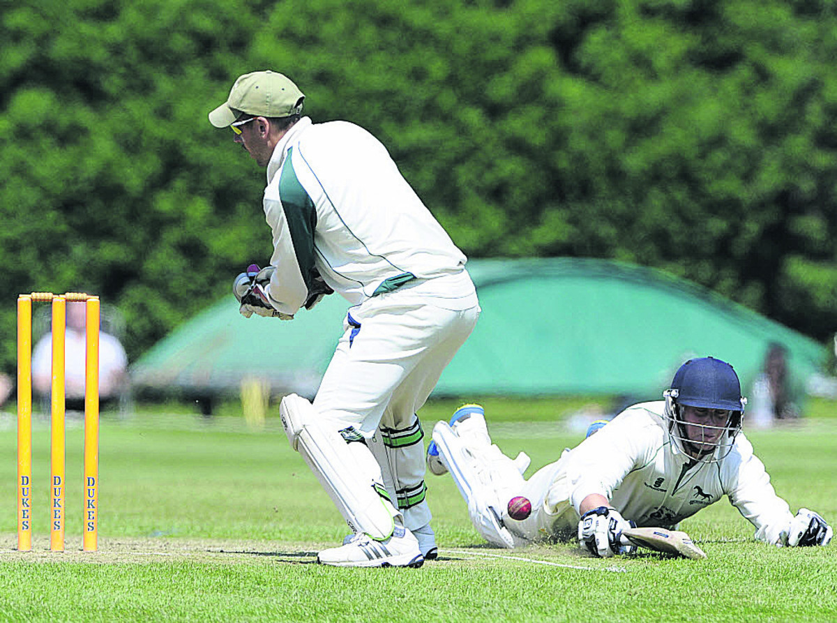 Wiltshire's top scorer Neil Clark just makes his ground as Dorset wicketkeeper Chris Park fails to hold a throw during Sunday's Trophy clash (Photo: Denis Murhpy)