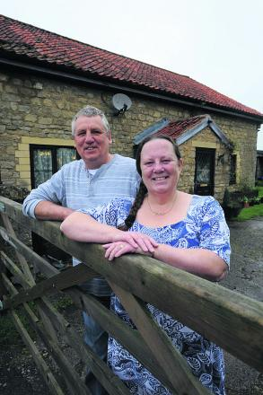 Graham  and Vicki  Hall, long-term fosterers, at their home