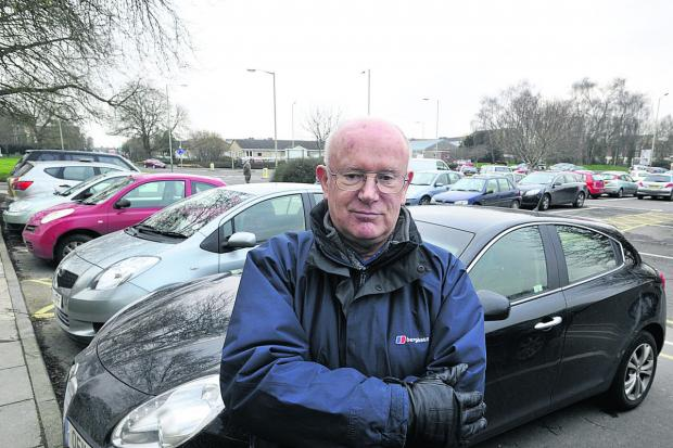 Wiltshire Times: Car parking campaigner John Fairbrother in the County Hall car park