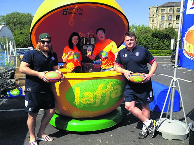 Bath players Ross Batty and David Wilson with Abbie Jackson and James Alford at the Jaffa stand