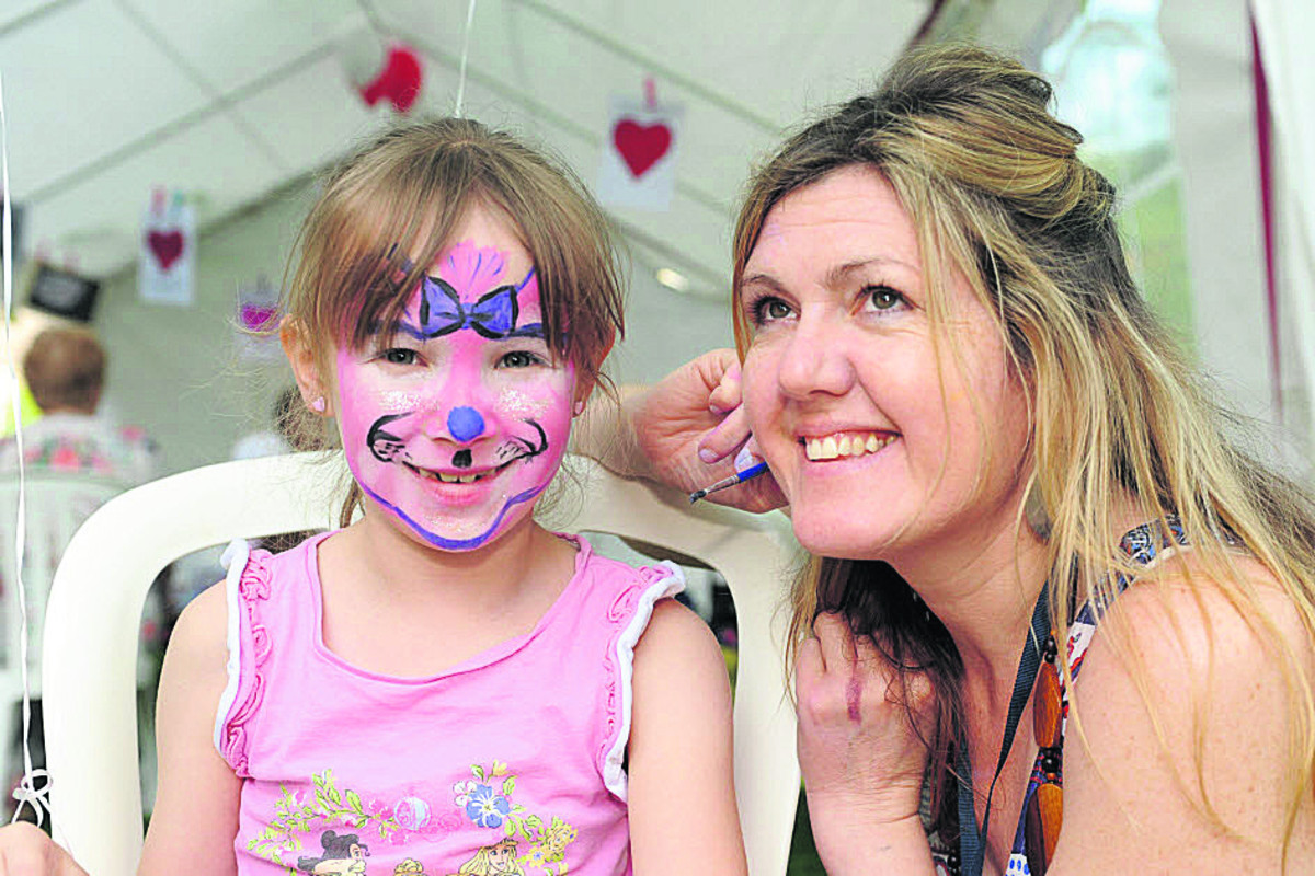Anna, seven, has her face painted  by Sarah Wilkins at the Freedom Festival at Westbury Gardens, Bradford On Avon, on Saturday
