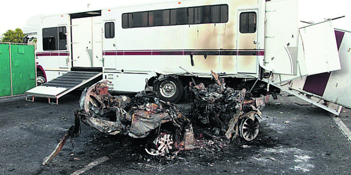 The horsebox and one of the cars involved in the pile-up; inset, left, owner William Harrison-Allan and, right, trainer Brian Meehan