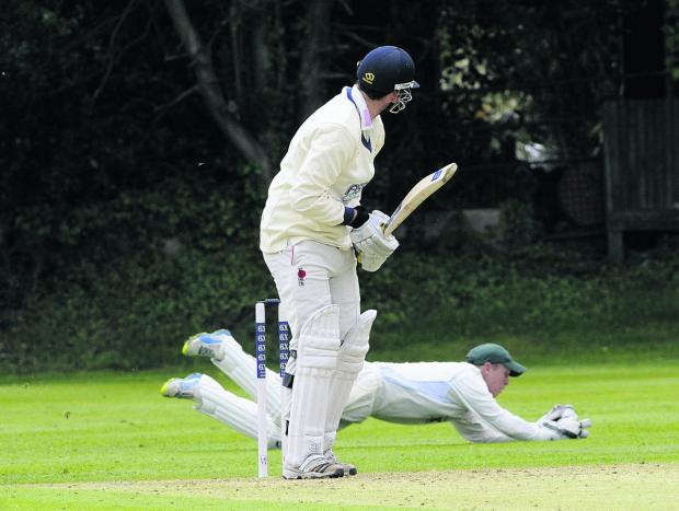 Wiltshire wicketkeeper Adam Miles dives for a catch against Wales