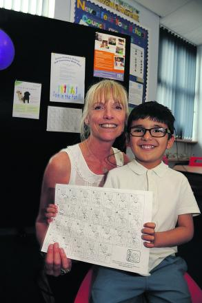 Liz Poyser, teacher of sign language at Grove School, with deaf pupil Abdullah