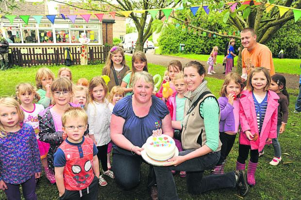 Dawn Bryant, nursery manager, and Lindsey Millen, joint chair, celebrate Westwood Nursery's 30th birthday with the children