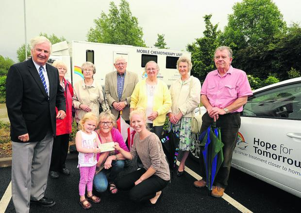 Wiltshire Times: Hermione Sonnet, four, helps her grandmother Er
