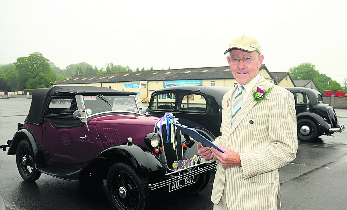 Tony Hale with his 1936 Morris Eight before the motor tour for vintage Morris vehicles. Photo: Trevor