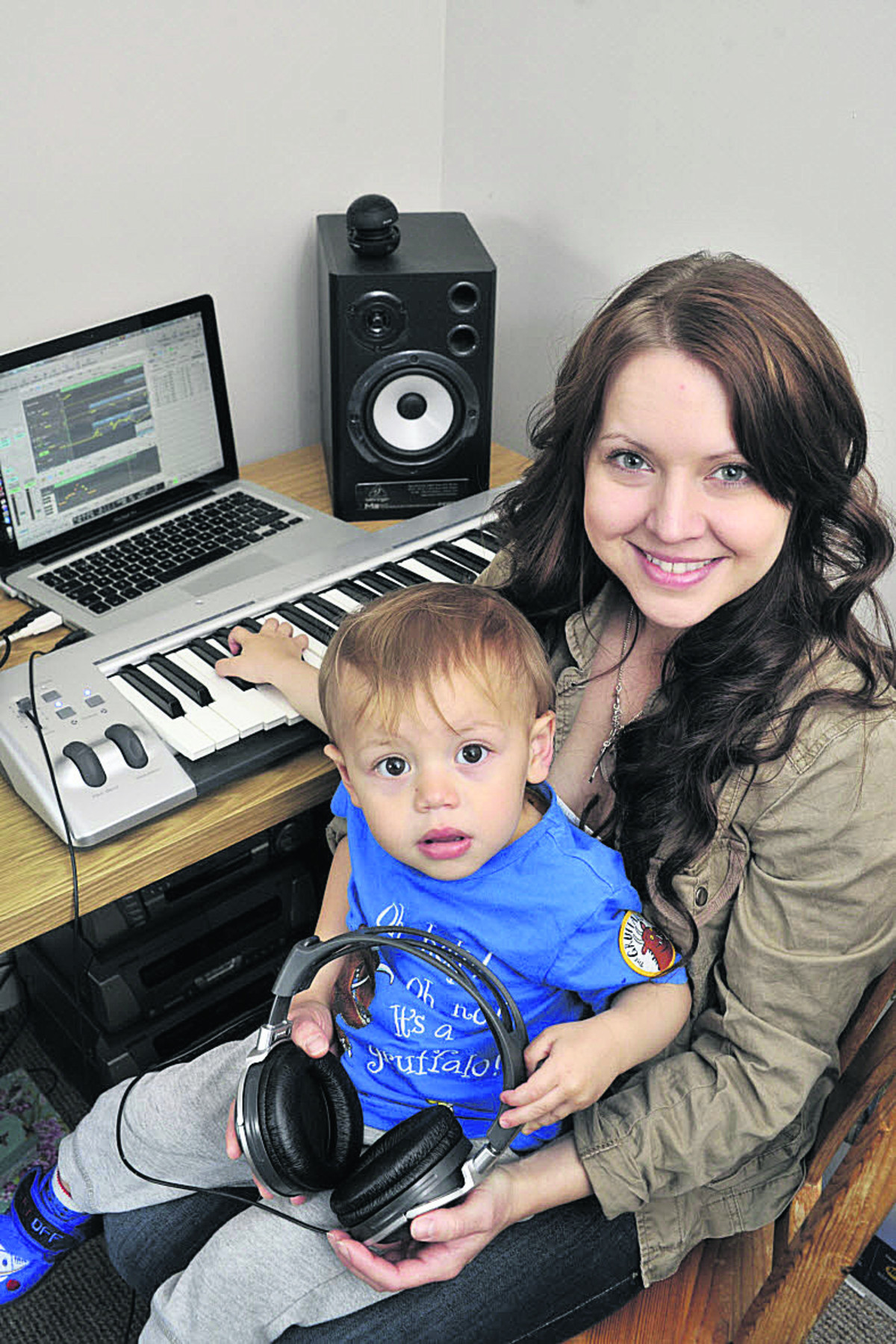 Part-time music producer Alexis Turvey of Melksham in her bedroom studio, with her son Luis Connors