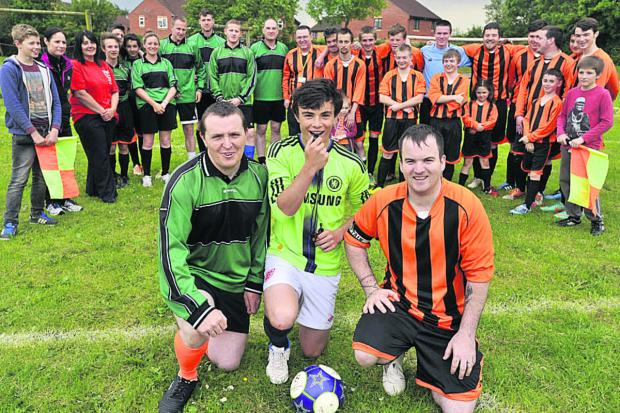 Wiltshire Times: Captains PCSO Matthew Till, left, and Luke Mattravis, right with referee Dean Goddard and the two teams
