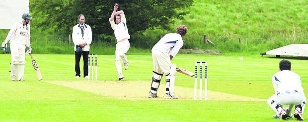 Heytesbury & Sutton Veny bowler Justin Wagstaff in action during his side's 50-run defeat at Avebury in Division Three on Saturday