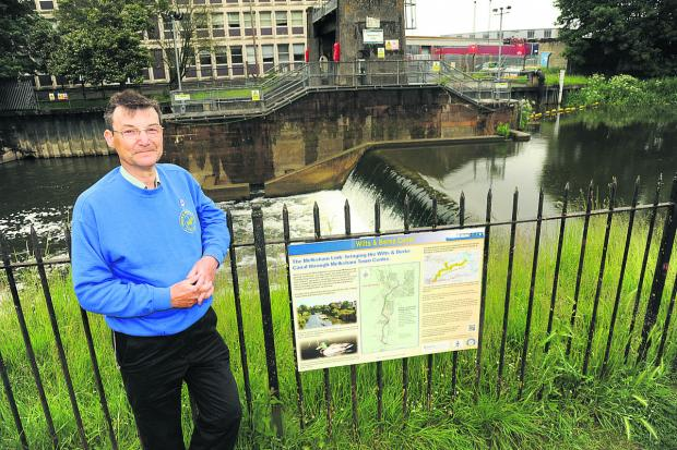 Chris Coyle with the Wilts & Berks Canal regeneration plan at Melksham weir