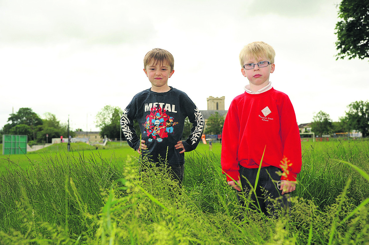 Sam and Max Griffin were fed up because they could not ride their bikes at the rec because of the long grass. Photo: Trevor Porter (TP49895)