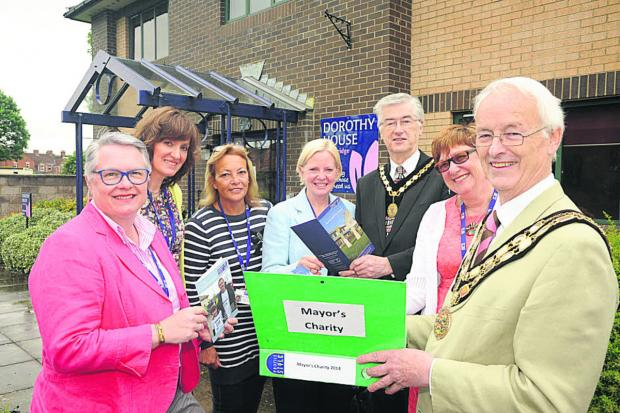 Trowbridge mayor Cllr Glyn Bridges, right, and deputy mayor Roger Andrews, with Dorothy House's Jayne Chidgey-Clark, Louise Clayton, Val Collins-Thomas, Liz Brown  and Gill Cannon
