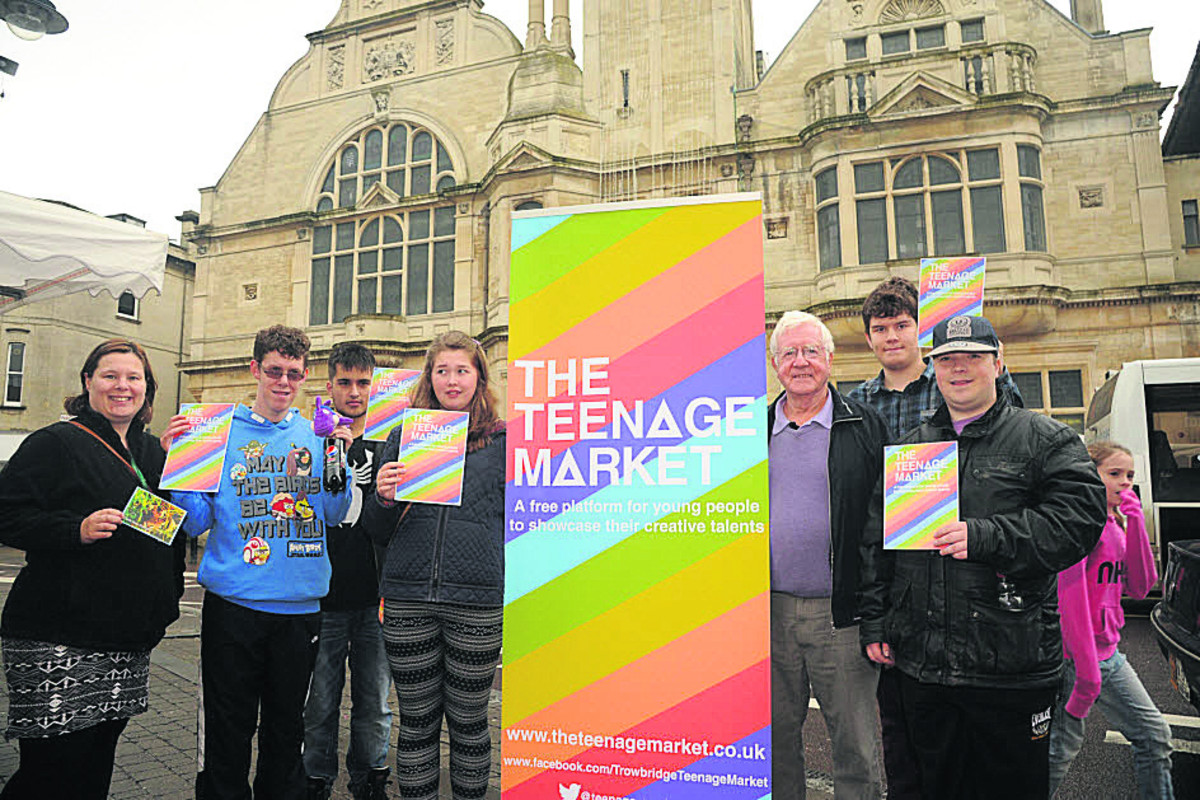 Youth Development coordinator Sam Shore, left, with youngsters taking part in the Teenage Market project under guidance from David Baker
