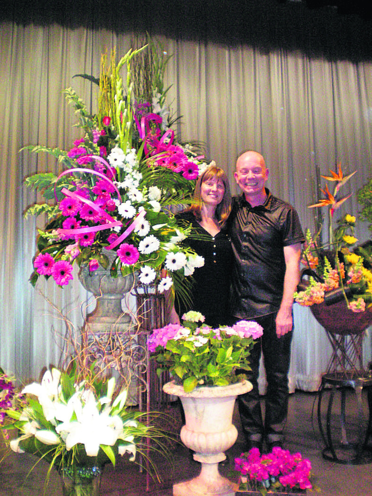 Demonstrator and TV personality Jonathan Mosley with some of the marvellous arrangements he created for Melksham & District Flower Arrangement Society recently, and club vice-chairman Caroline Smyth, who assisted him on stage.