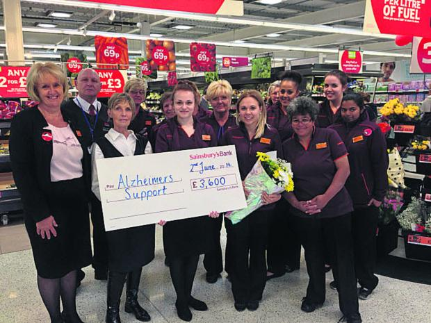Sainsbury's staff hand over £3,600 to Alzheimers Support