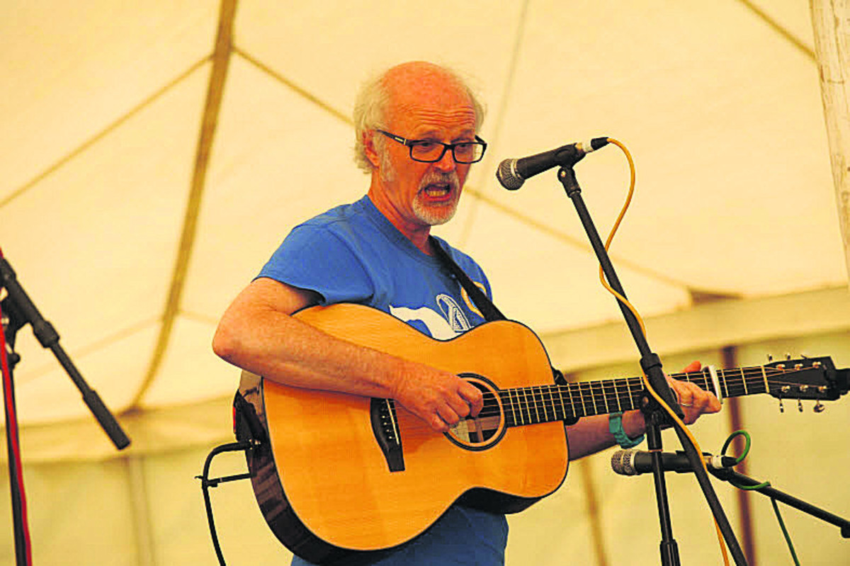 'Woody' sings blues and folk songs in the acoustic section