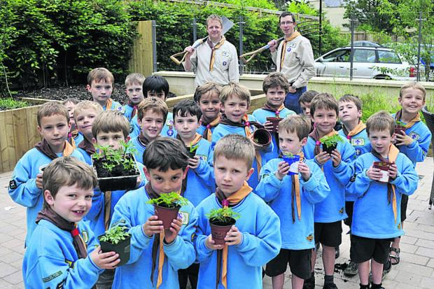 The 1st Bradford on Avon Beavers planting flower beds at the Wiltshire Heights Care Home on Tuesday