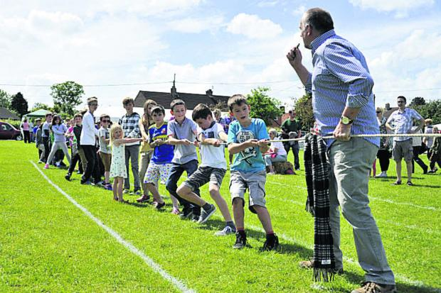 Clive Bates gives the order to take the strain as youngsters take on parents in the tug- of-war