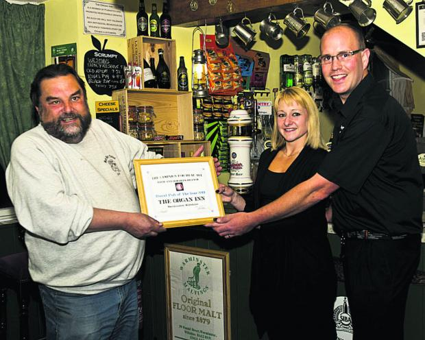 Dennis Rahilly of CAMRA with Daniel and Carly Keene of The Organ Inn, Warminster