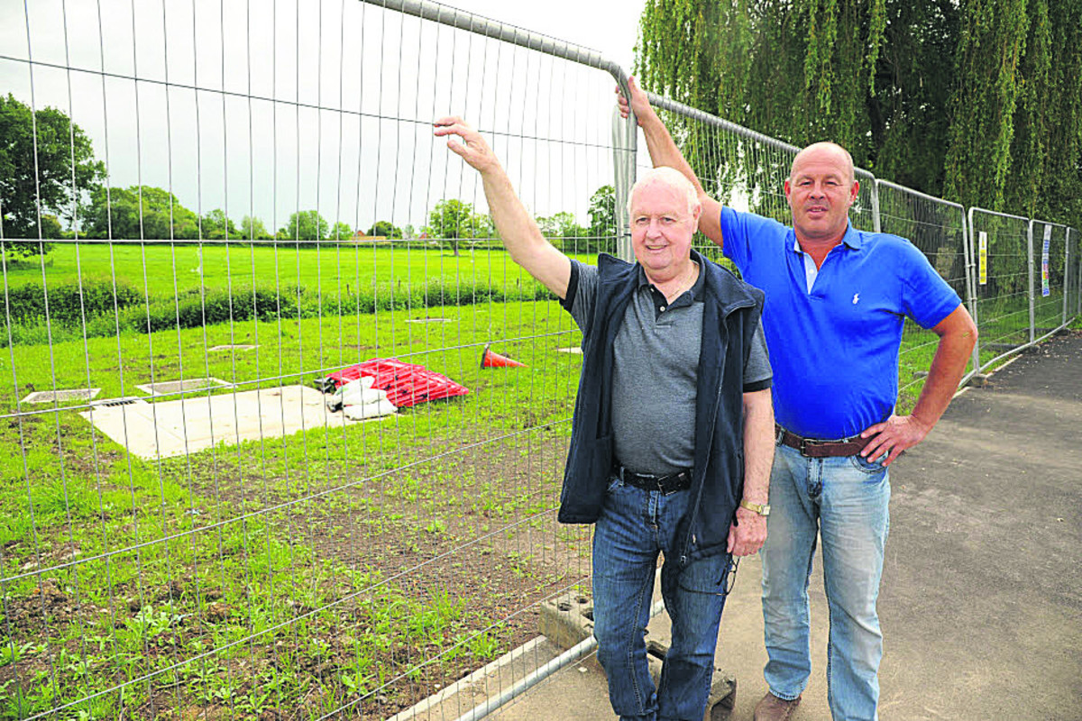 Brookmead residents Eamonn Doyle and Paul Weightman are concerned about the way the play area was left by Wessex Water