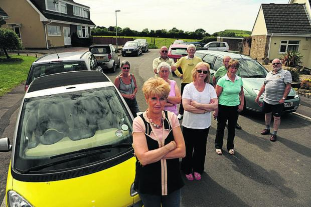 Sandra George and other residents of St Andrews Road, Warminster, who are protesting against Redrow's plan to use the road as access