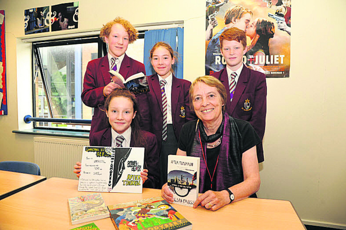 Gillian Cross with cover design winner Ella, seated, and fellow pupils Archie, Annabel and Kyle