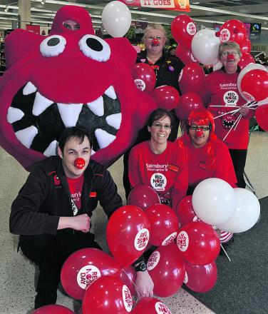Staff at Sainsbury's in Trowbridge take part in Red Nose Day last year. Funding from Comic Relief will help hundreds of isolated older people in Wiltshire