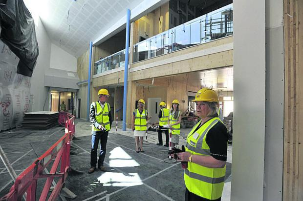 Wiltshire Times: Council leader Jane Scott takes a look inside the atrium of Corsham's Springfield Campus