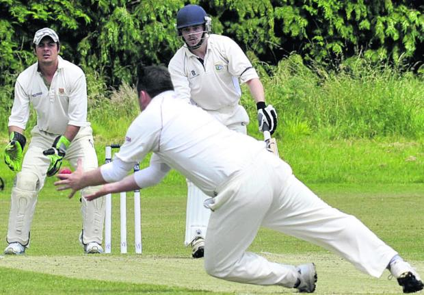 Trowbridge's Nick Green is caught and bowled by Nationwide House's Russell Artley during Saturday's Wiltshire Division clash at the County Ground  Photos: Glenn Phillips (49508-12-15)