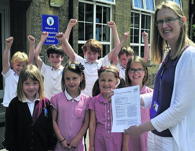 Headteacher Tracey Dunn and pupils celebrate Fitzmaurice Primary School's Ofsted report            Photo: Glenn Phillips (49486)